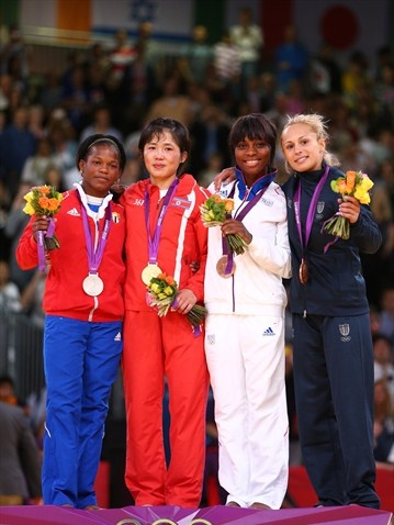 Silver medalist Yanet Bermoy of Cuba, Gold medalist Kum Ae An of DPR Korea, Bronze medalist B Priscilla Gneto of France, and Bronze medalist A Rosalba Forciniti of Italy pose after winning the women's -52 kg Judo on Day 2 at ExCeL on July 29