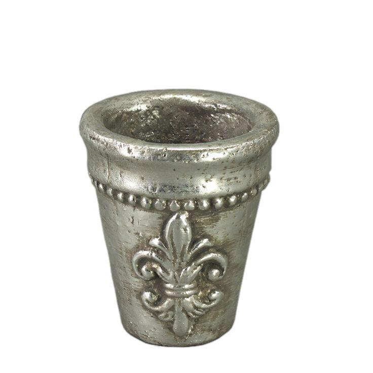 Niciodată un simplu ghiveci de flori nu a reuşit să stârnească atâta interes pregum ghiveciul argintiu cu finisaj metalic. Ghiveciul este realizat din ceramică însă datorită finisajului impecabil arată precum o piesă de artă. Având gravat pe el simbolul crinului florentin acest ghiveci arată mai mult ca un pocal bine făurit de pe mesele cavalerilor.