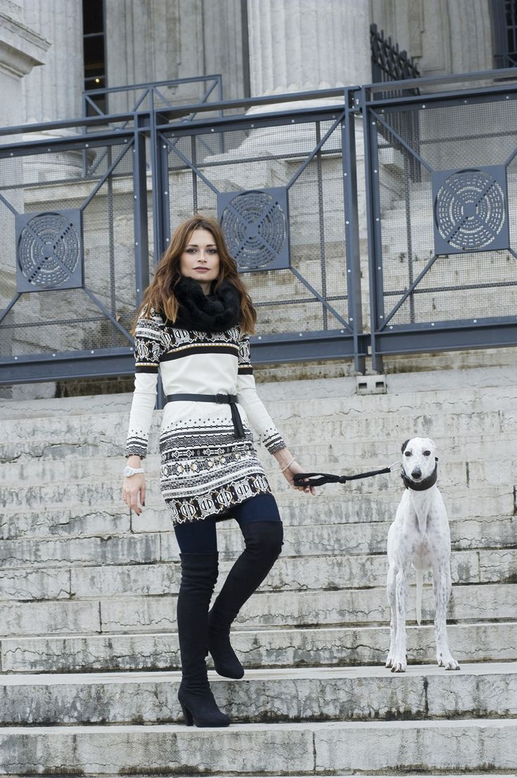 Shop this look on Lookastic:  http://lookastic.com/women/looks/scarf-sheath-dress-watch-leggings-over-the-knee-boots/6432  — Black Fur Scarf  — White and Black Fair Isle Sheath Dress  — White Watch  — Navy Leggings  — Black Suede Over The Knee Boots