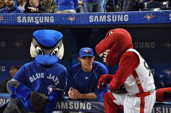 Jays and Raptors mascots have a chat with Jays pitcher Aaron Sanchez