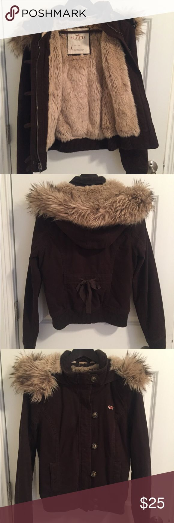 Soft Fur Brown Bomber Coat Jacket Large Hollister This brown bomber jacket from Hollister is in like new condition. The fur is SUPER soft and is on the interior of the coat, as well as inside the hood. The fur rim on the hood is removable. Hollister Jackets & Coats