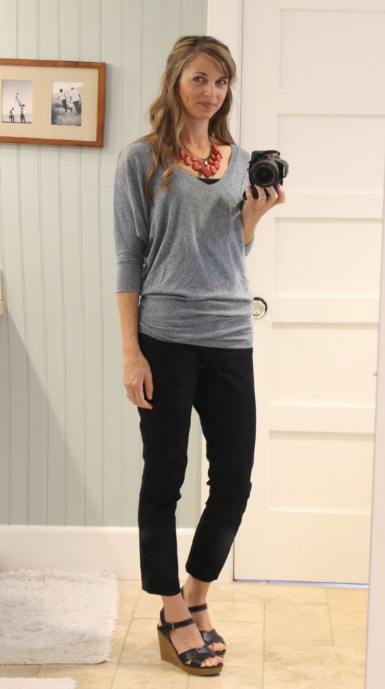 grey dolman top, black pants, colorful statement necklace, wedges