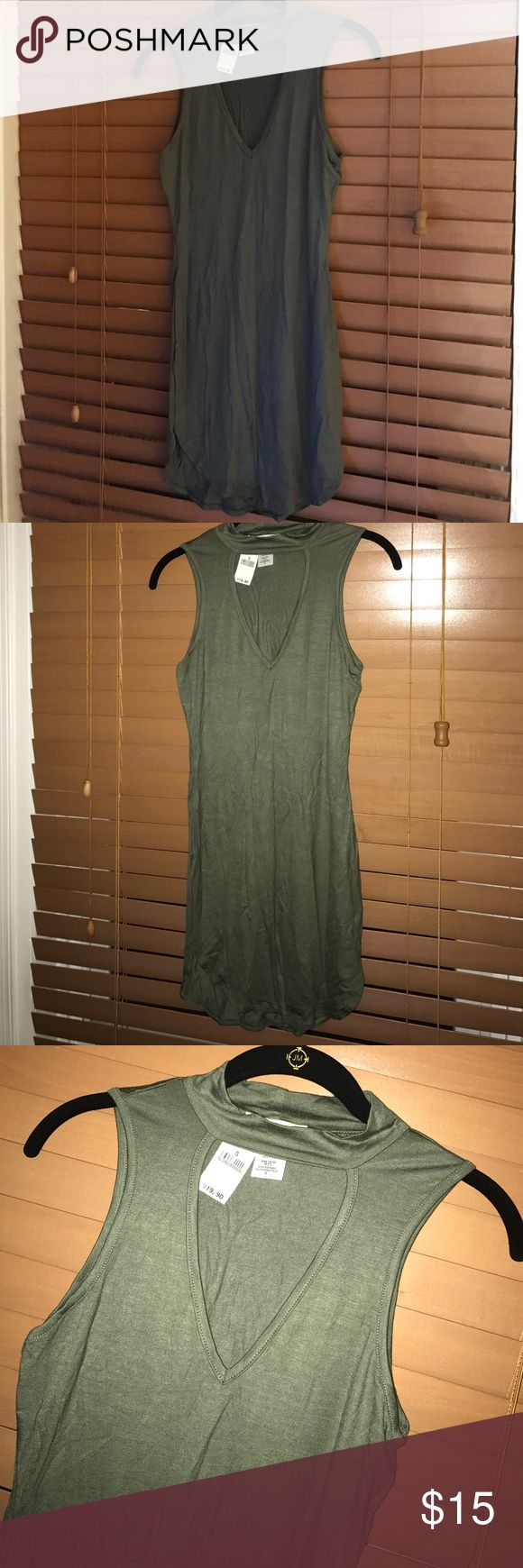 Olive Green Sleeveless Wet Seal Dress Olive Green  Sleeveless Mock Turtleneck  V shape cut out right above chest  Curved hem 95% Rayon  5% Spandex Wet Seal Dresses Mini
