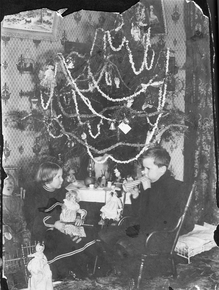 Children with gifts near christmas tree circa 1900 from