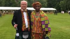 "Professor & Mrs Struther -  A photograph of a Scottish academic with his Ghanaian wife has provoked a conversation on social media about interracial relationships.  On 26 December, the Honorary Consul for Ethiopia in Scotland, Professor John Struthers, shared an image on Twitter of himself and his wife Justina attending the Queen's garden party in Edinburgh in July.  ""We haven't wavered! The best way of fighting racism is living your life, standing tall and educating. #Diversity"""