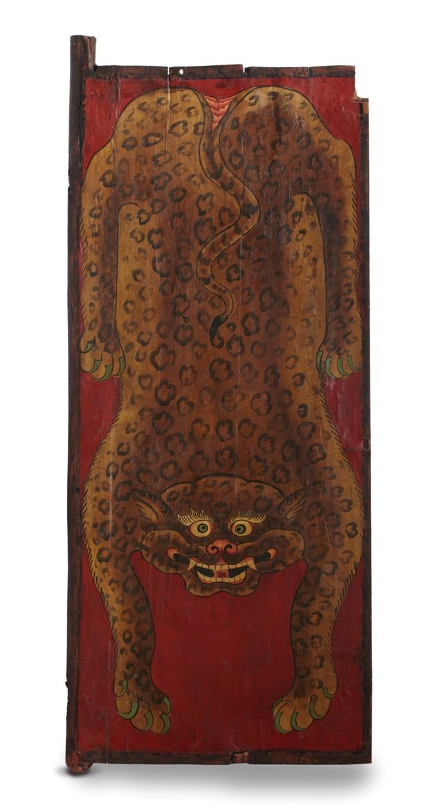 The Earth installation in the Museum, conceived by #RajeevSethi has a composition of 64 tiger doors from North East India, this is one such door. This is a Buddhist prayer room door. In Tibetan  iconography, the flayed leopard skin is often used as a mat or seat (asana) of dakinis or wrathful goddesses. The wearing of leopard skin therefore represents the yogin's control over pride and offers protection to the meditator from outside harm or spiritual interference.
