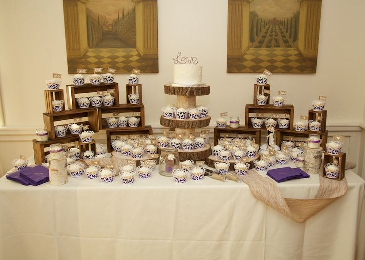 DIY- Rustic wood wedding cake/cupcake tower and crates. We stained unfinished wooden crates. Glued together cupcake/cake tower with circle wood planks and birch blocks.Burlap&lace rolls, used to decorate tables. Rustic wedding, rustic cake table, rustic cupcakes.