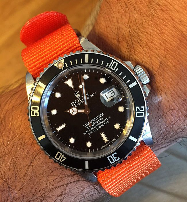 Rolex 16610 Submariner Stainless Steel Watch Black Dial/Black Bezel Orange Strap #Rolex #LuxurySportStyles