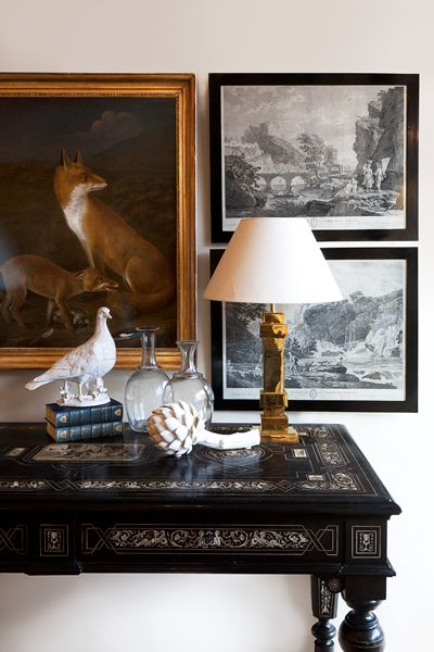 The richness of ebony ivory inlaid table. The warmth of bronze lamp. Julia Boston antiques