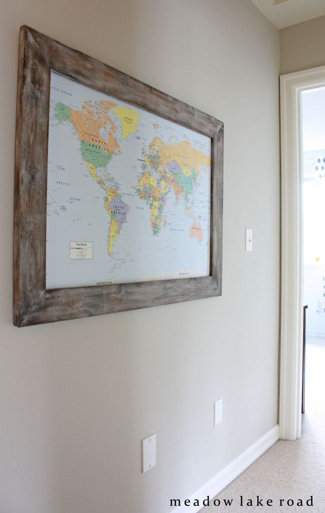 hallway with framed map