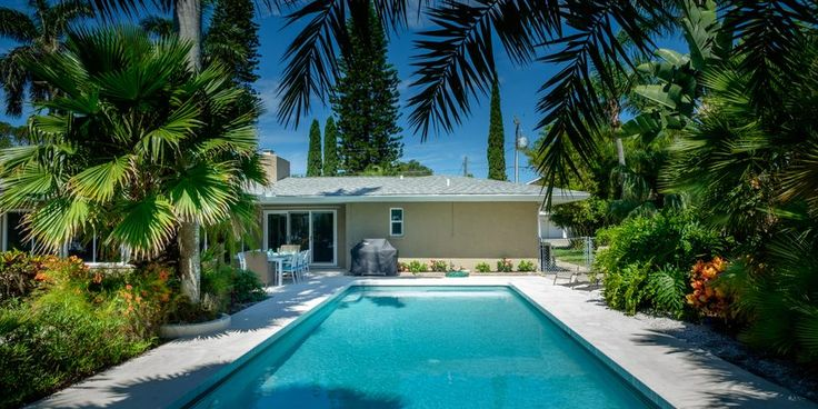 """Escape to Paradise at """"Max and Denise"""". This lovely 3 bedroom home with Olympic sized pool, has been newly renovated and offers everything you could possibly need to make your Island stay memorable. 1 block from shopping 2 blocks to Beaches and secluded on a canal. Learn more at http://beachrentals.mobi/"""