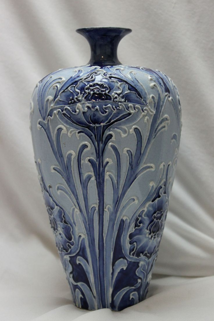 This Moorcroft vase is decorated with the Poppy design from the Florian range. C 1900. www.chinaroseantiques.com.au