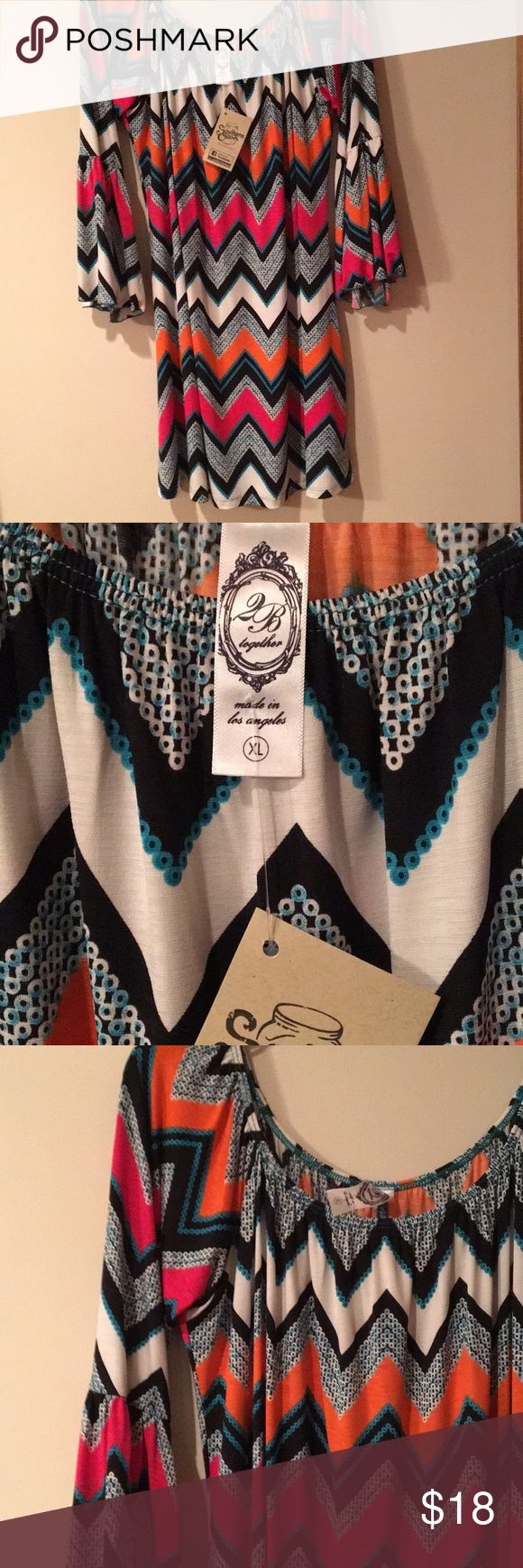 Chevron Print Dress Chevron print dress with pink, orange, and white chevrons accented in teal blue.  Perfect with leggings or with as a cute summer dress.  Bell sleeves with riffle below the elbow. 2B Together Dresses Mini