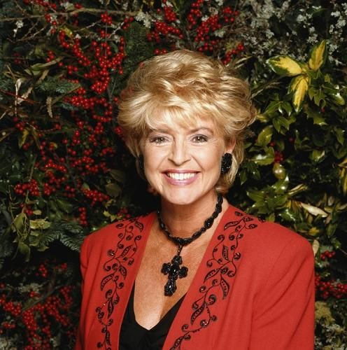 """Gloria Hunniford In Garden by Terry O'Neill   Television presenter Gloria Hunniford.  Limited Edition C-Print Signed and Numbered  16"""" x 16"""" / 20"""" x 20""""  24"""" x 24"""" / 30"""" x 30""""  40"""" x 40"""" / 48"""" x 48"""" / 60"""" x 60"""" / 72"""" x 72""""  For questions or prices please contact us at info@igifa.com    IGI FINE ART"""