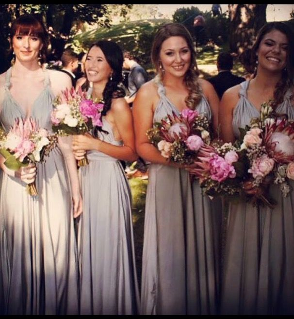 One of our fantastic bridal parties in silver. Winning colour with those flowers. Zeredah Convertible Dresses available in Perth at Nora and Elle Bridesmaids.