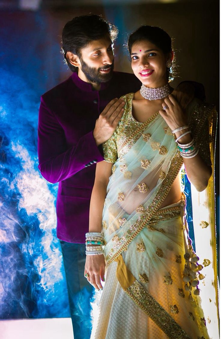 Indian wedding photography. Couple photoshoot ideas. Candid photography. Love the bride's pastel coloured half saree and diamond jewellery.