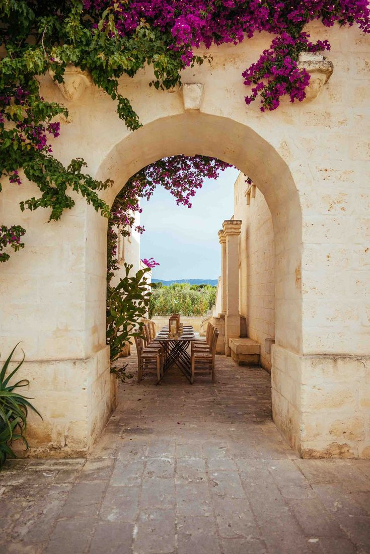 The perfect table setting in Italy at Borgo Egnazia in Puglia overlooking olive …