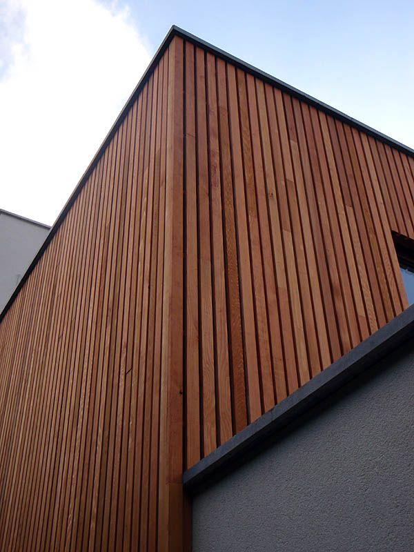 Revêtement extérieur posé à la vertical pour donner impression de grandeur