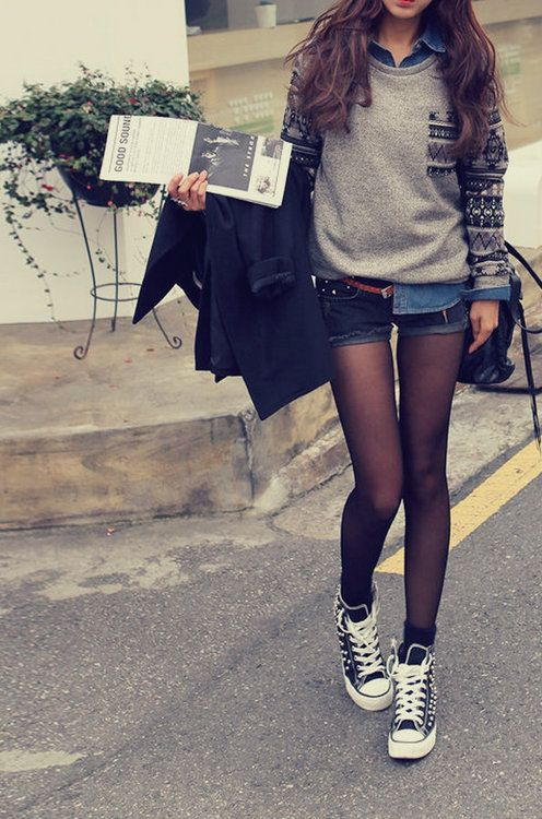 Sheer black tights, shorts, chambray, gray tribal sweater, and studded Converse.