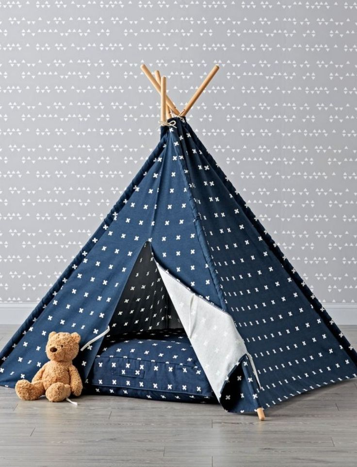 Shop Navy Cross Print Teepee.  Our Navy Cross Print Teepee keeps it clean and classic.  Designed just for us by Ampersand Design Studio, it's topped with a simply stylish print that's sure to match the décor in almost any playroom or kids room.