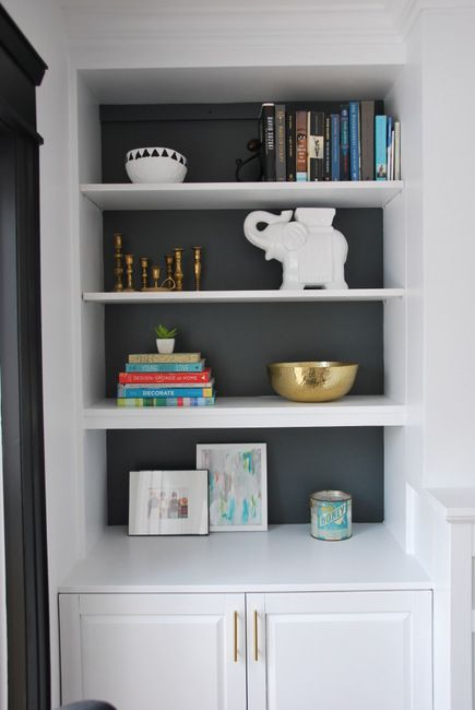 styling built in shelves around fireplace; integrating brass details, artwork, books, and vintage wares (via the sweetest digs)