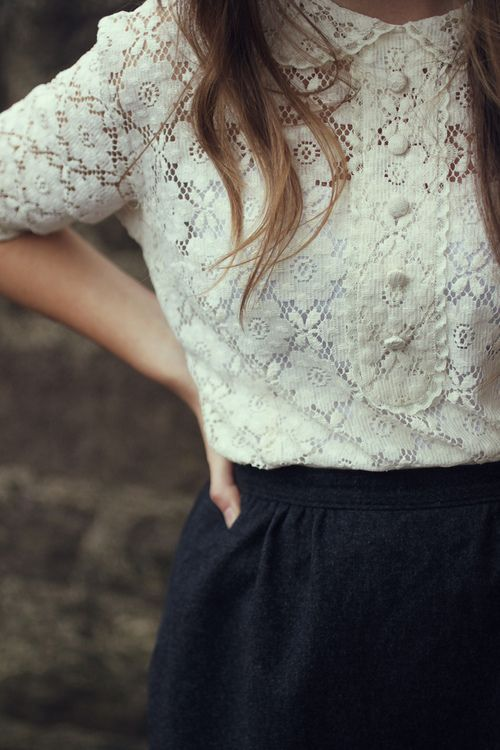 Feminine white lace button up shirt with a peter pan collar and blue skirt