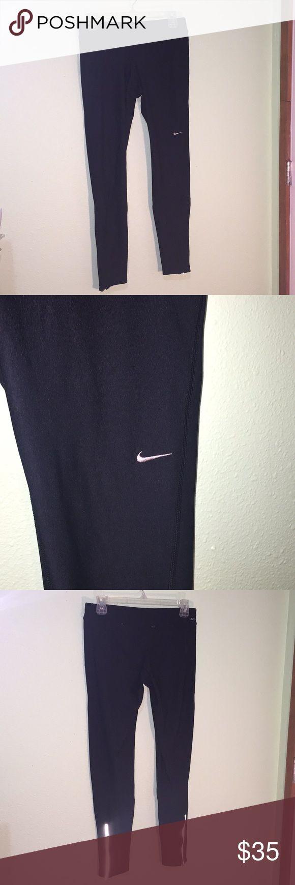 Nike Running Tights Size Medium Dri Fit Nike running leggings. Excellent used condition, barely worn. No pilling, holes or stains. Includes a Drawstring for a more custom fit. Zippers at the bottom of each leg with reflective strips. Nike Pants Leggings