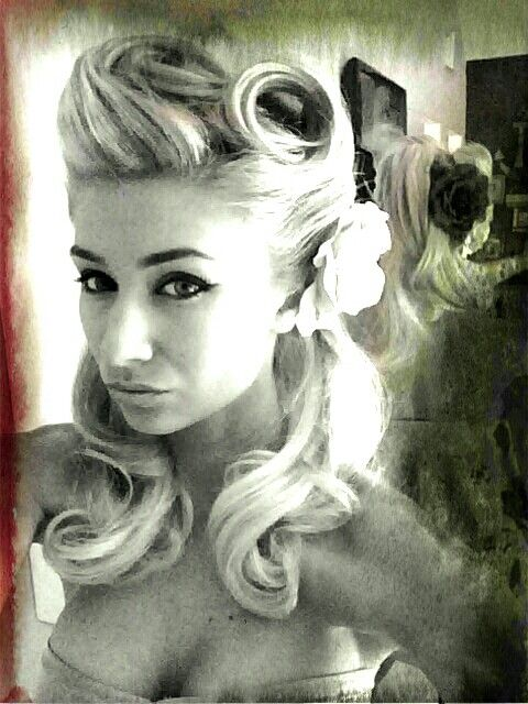 Vintage pin up hairstyle....LOVE the top of her hair