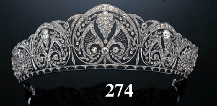 A gorgeous, delicate as lace diamond tiara, with at least five highly intircate panels, sold via Christie's quite a while ago. Only to pop up again.....