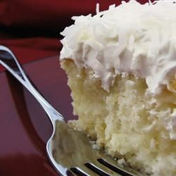 "Coconut Poke Cake | ""This cake is wonderful. It is so moist and delicious. My all time favorite. If you could rate it more than 5 stars I would."""