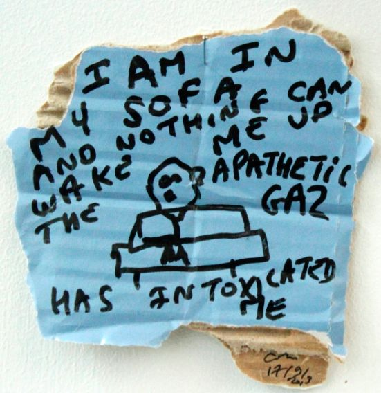 """I am in my sofa, and nothing can wake me up. The apathetic gas has intoxicated me,black marker text and drawing on carton, 14 x 15 cm / Biennalist  #BERLINBIENNALE  : Fear of content """" ( Berlin Biennial )"""