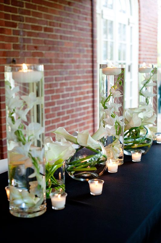 Like the white orchids with the floating candle and the for Fish centerpieces wedding receptions