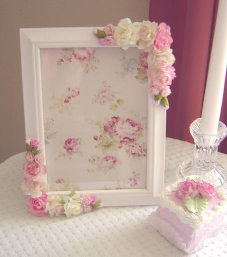 Old wooden photo frames re finished trimmed in roses and other silk flowers & trimmed with pearl strings around the edges.