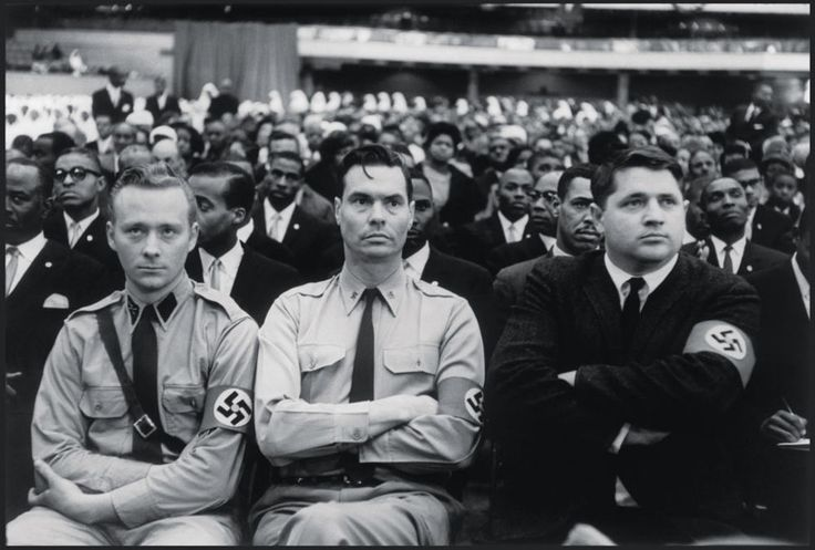 George Lincoln Rockwell (center), head of the American Nazi Party, at a Black Muslim meeting, 1961.