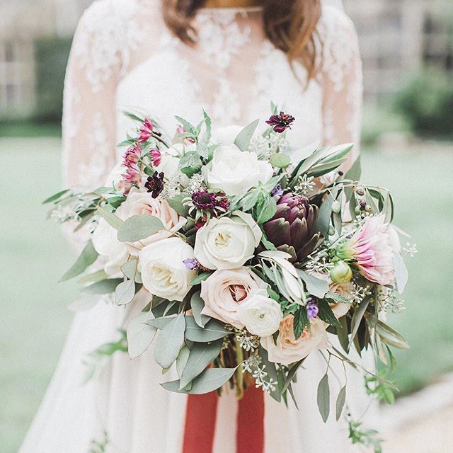 Yes, that's an artichoke in the bouquet—and it looks absolutely stunning!  Click the link in our bio for more ideas on how to incorporate fruits and veggies into your floral arrangements. #theknot : @annamarie_akins | Florals: @amanda.burnette