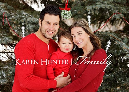 Coordinate your wardrobe.  The contrast of red with a green tree will make your family photo pop and look very professional.