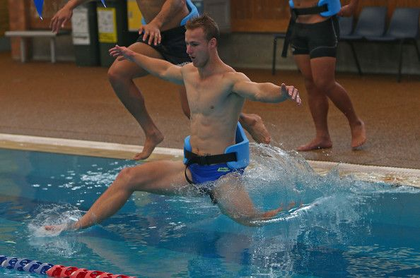 Daly Cherry Evans jumps into the water during a Manly Sea Eagles NRL pool session at Warringah Aquatic Centre on May 13, 2014 in Sydney, Aus...