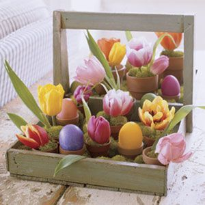 Easter table centrepiece with tulips and colored eggs