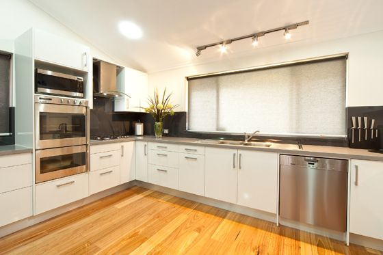 white cupboards, light colour bench