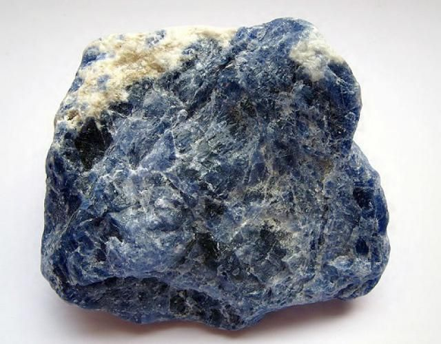 The Silicate Minerals: Sodalite Sodalite, Na4Al3Si3O12Cl, is a feldspathoid mineral found in low-silica igneous rocks. The blue color is distinctive, but it may also be pink or white.