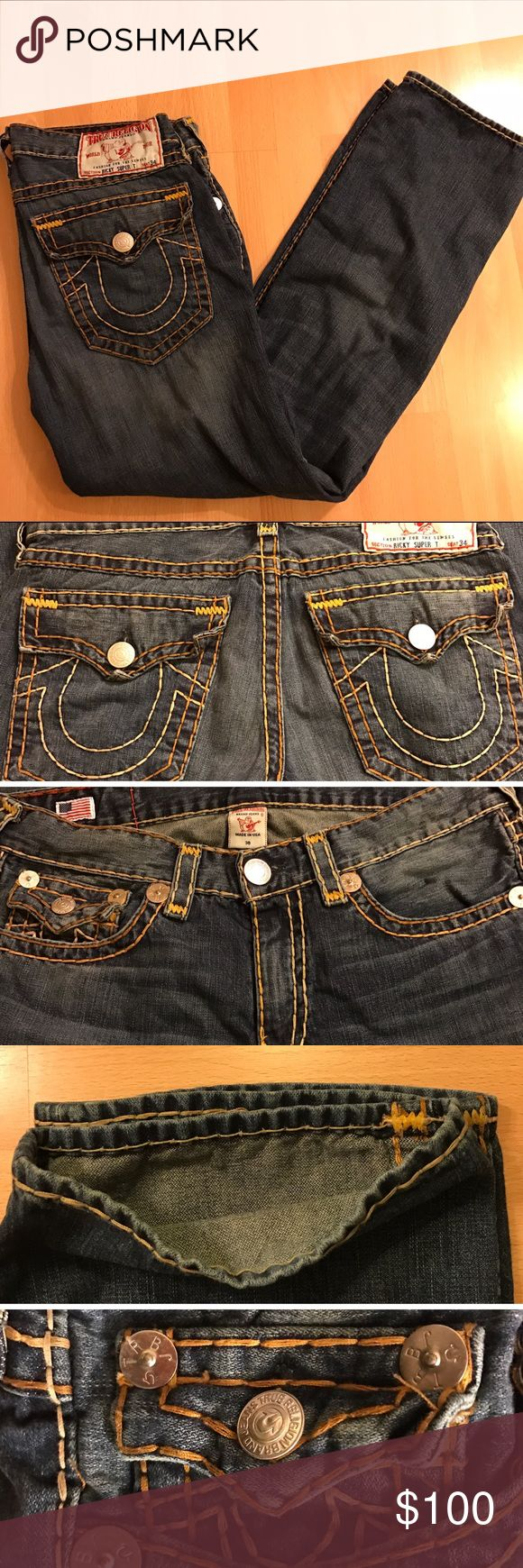 True Religion Ricky Super T Jeans For sale is a lightly used pair of True Religion jeans in the Ricky straight style. Blue denim with faded color style around the knee area. Super T stitching in a high contrast gold and orange style. Folding on back pockets due to how jeans were kept in storage. Pants length is 32 inches from crotch to bottom hem. Message if any questions. True Religion Jeans Straight