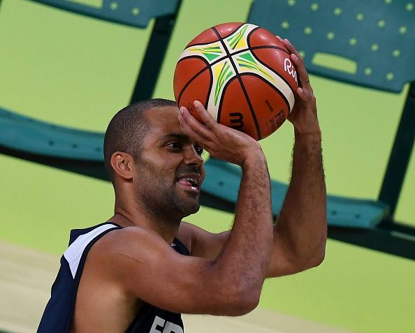 #RIO2016 Tony Parker of France prepares to take a shot during a training session for the French men's basketball team ahead of the Rio 2016 Olympic Games at...