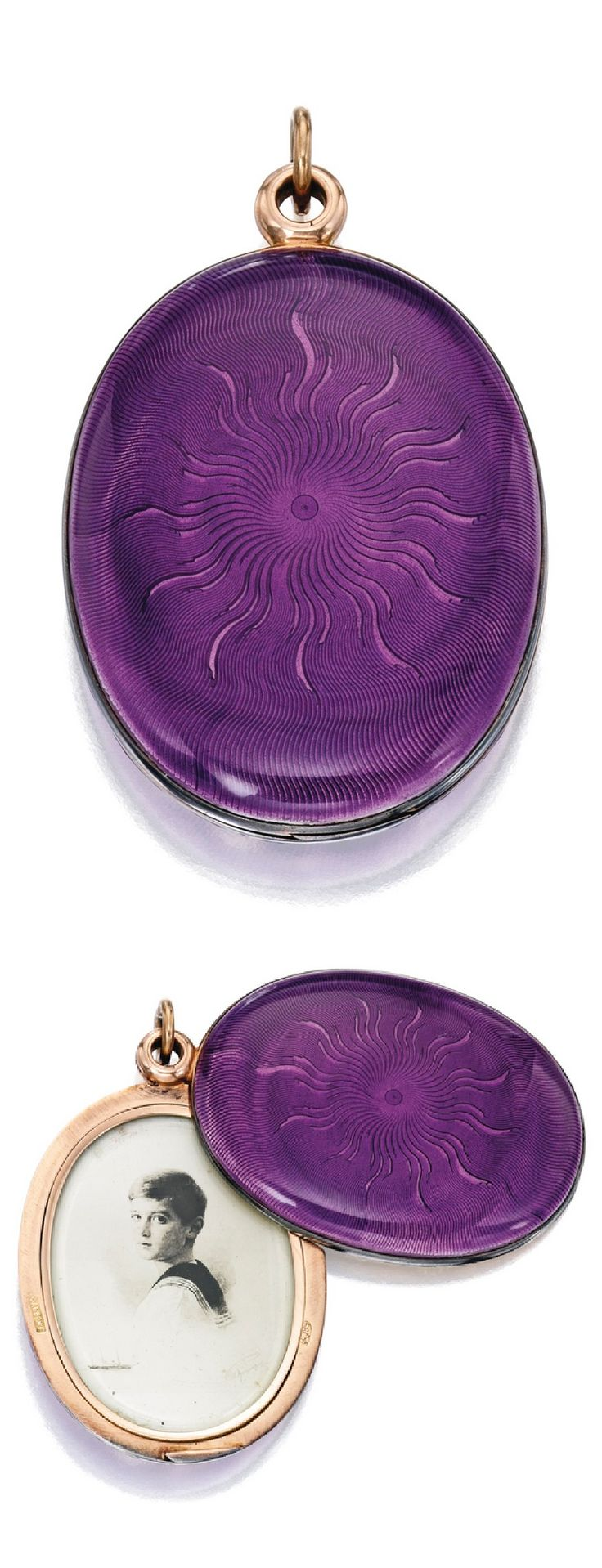 Fabergé - An antique gold, silver and guilloché enamel pendant-locket, workmaster Henrik Wigström, 1899-1908. The oval pendant with dark lavender enamel over a sunburst guilloché ground, the interior fitted with a mirror facing a portrait of Tsarevich Alexei Nikolaevich, stamped Fabergé, with Russian hallmark and workshop mark for Henrik Wigström. Accompanied by a lock of hair which was encased in the interior of the piece. According to family tradition, this hair is that of Tsarevich…