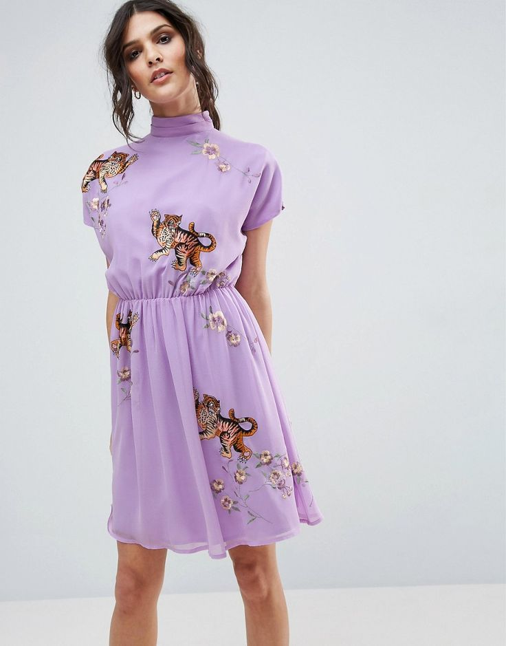 Buy it now. ASOS PREMIUM Open Back Tea Dress with Tiger Embroidery - Purple. Dress by ASOS Collection, Woven fabric, Embroidered design, High neckline, Fully lined, Open back with button closure, Regular fit - true to size, Hand wash, 100% Polyester, Our model wears a UK 8/EU 36/US 4 and is 173 cm/5'8� tall. ABOUT ASOS COLLECTION Score a wardrobe win no matter the dress code with our ASOS Collection own-label collection. From polished prom to the after party, our London-based design team…