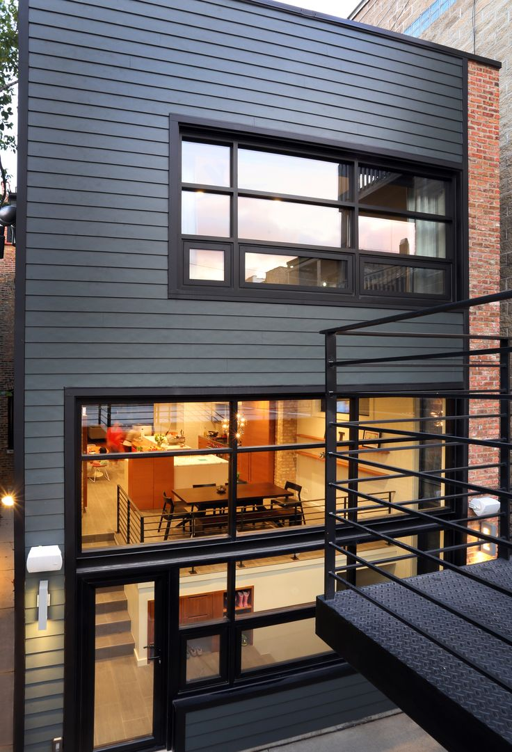 The rear addition is clad in James Hardie's Fiber Cement siding.