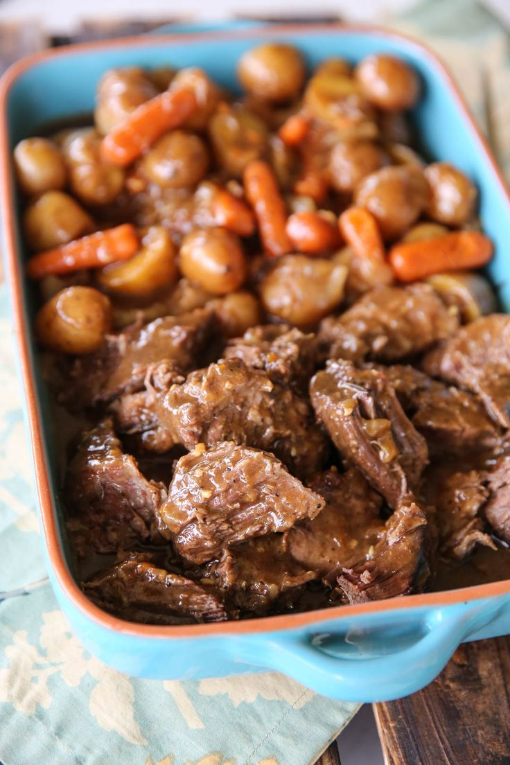 Simple ingredients lead to a warm and comforting meal of tender pot roast with potatoes, carrots, and onions with gravy! All cooked in the oven.