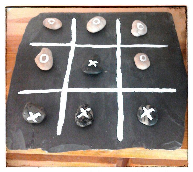Repurposed slate roof tile + pebbles + tipex = noughts & crosses board game