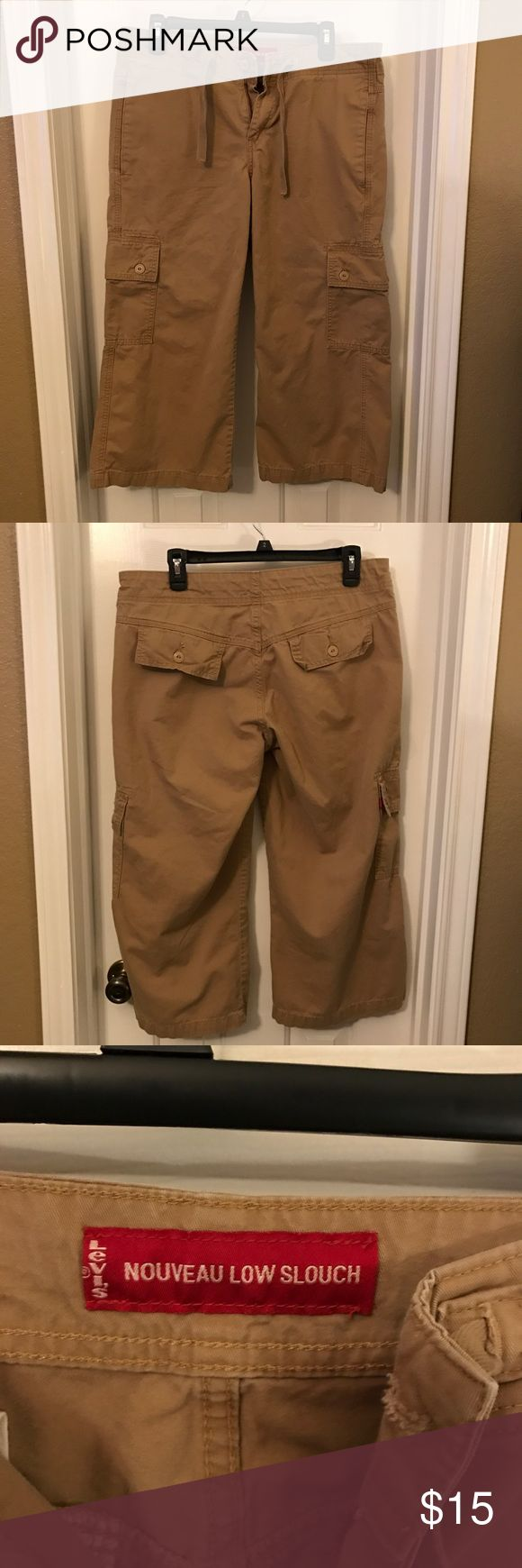 "Levi's Khaki Capri Cargo Pants Size Medium EUC Levi's Nouveau Low Slouch Khaki Capri Cargo Pants Size Medium. They are in excellent condition--no rips, holes or stains. They were only worn a couple of times. They have an outside drawstring. Inseam is about 22"". Material is 100% cotton. Smoke-free home. Levi's Pants Capris"