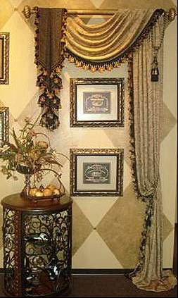 What a dramatic way to showcase artwork. I don't think I would have thought to use a drapery panel & valance!