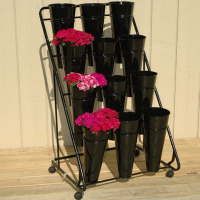 """These metal vases are ideal for displaying cut flowers and arrangements. Each is 7-1/2"""" in diameter and 16.5"""" high, large enough to hold  the longest stems."""